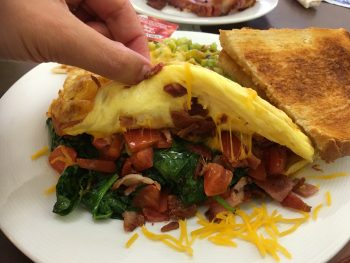 White Box Cafe & Bakery Create Your Own Omelet (bacon, spinach, cheddar, tomato)